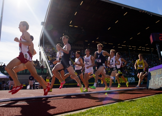 June 5 - Competitors in the men's 1,500 meter race pass by the start/finish line on Day 2 of the NCAA Track and Field Championships at Hayward Field in Eugene, Oregon. (Michael Arellano/Emerald)