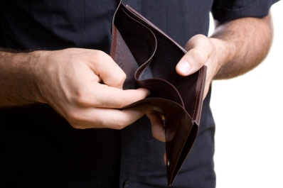 Man showing empty wallet