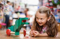 Girl in Toy Store --- Image by © Tim Pannell/Corbis